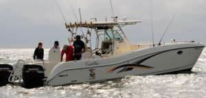 Fishing boat on water | Frazier's Guide service